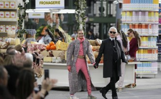 "German designer Lagerfeld and model Delevingne appear at the end of his Fall/Winter 2014-2015 women's ready-to-wear collection show for French fashion house Chanel at the Grand Palais transformed into a ""Chanel Shopping Center"" during Paris Fashion Week"