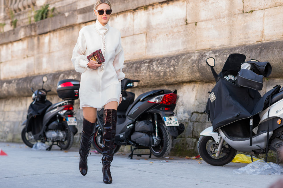 black-and-white-oxford-shirt-black-over-the-knee-boots-black-and-whtie-paris-fashion-week-street-style-fall-outfits-elle