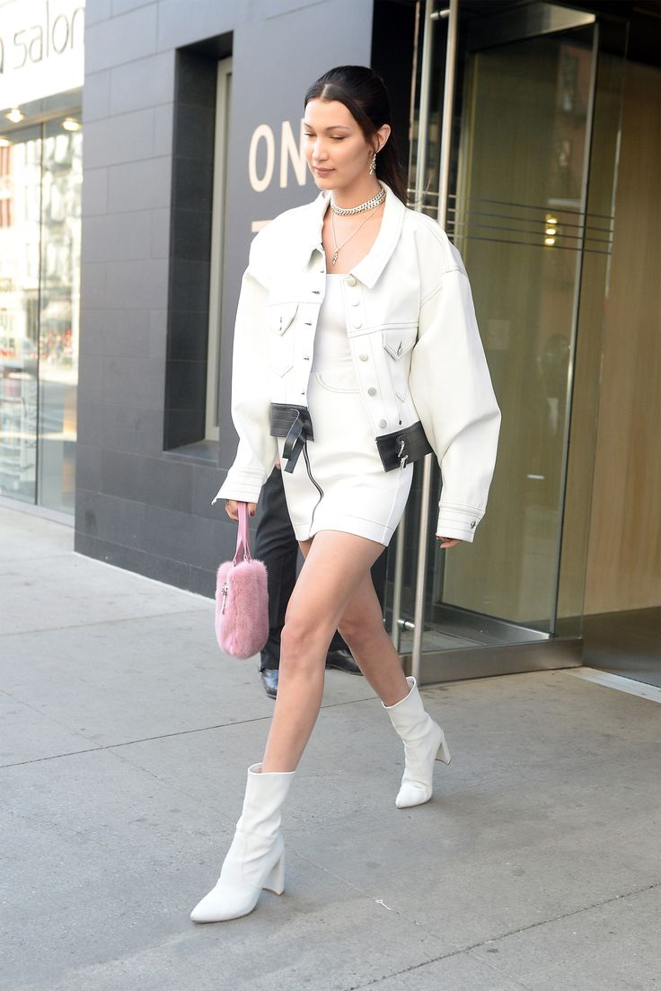 Model Bella Hadid is seen leaving her apartment wearing a white leather dress with matching boots while going to a photoshoot in New York City, New York. Pictured: Bella Hadid Ref: SPL1474630  050417   Picture by: Elder Ordonez / Splash News Splash News and Pictures Los Angeles:310-821-2666 New York:212-619-2666 London:870-934-2666 photodesk@splashnews.com