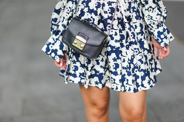 PARIS, FRANCE - JUNE 24: Amelie Lloyd wears sunglasses, a Marc Jacobs flower print dress, a white corset, a Furla bag, during Paris Fashion Week - Menswear Spring/Summer 2018, on June 24, 2017 in Paris, France. (Photo by Edward Berthelot/Getty Images)