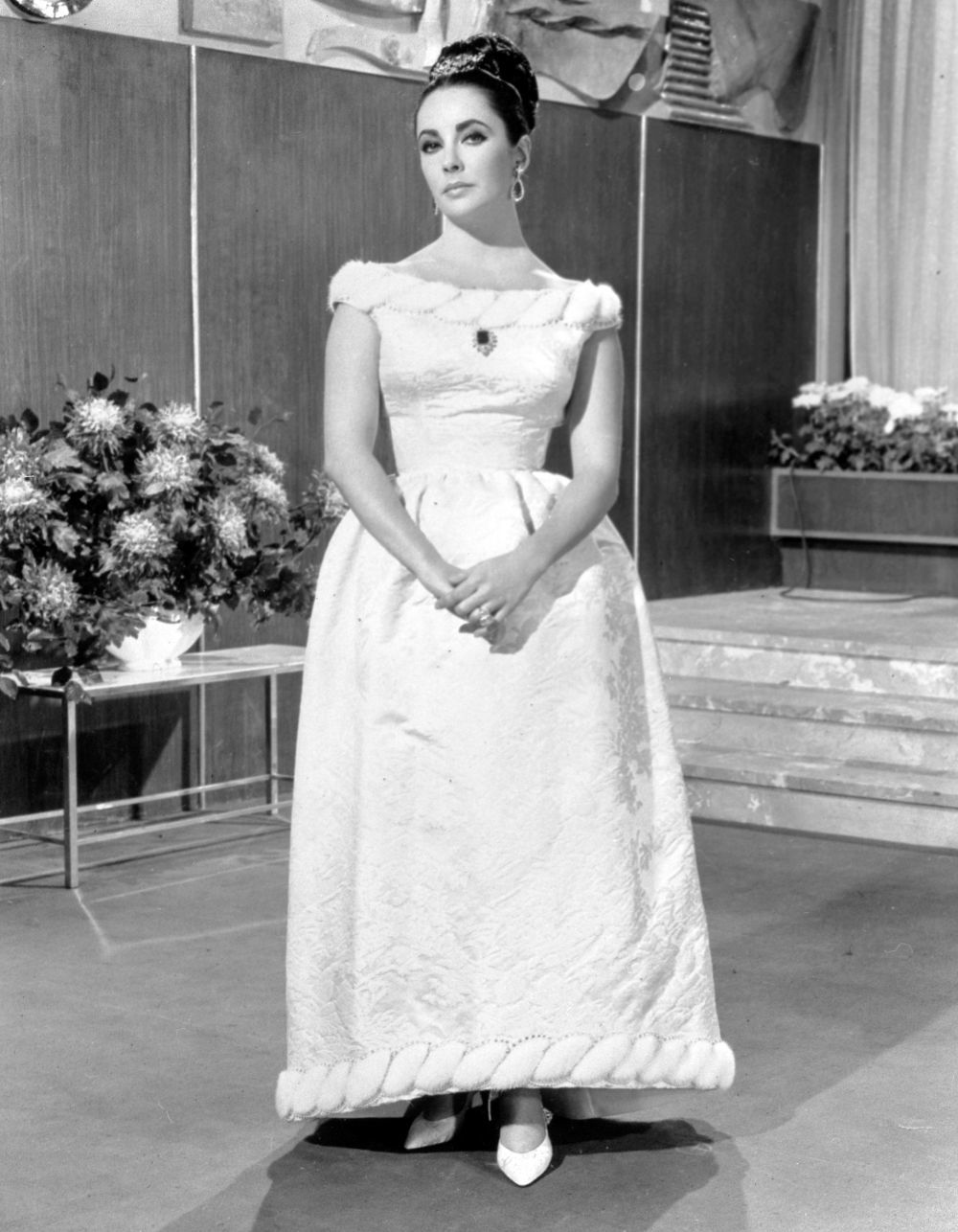 """Actress Elizabeth Taylor dressed in a Givenchy ball gown for her new film """"The VIPs"""". (Photo by PA Images via Getty Images)"""