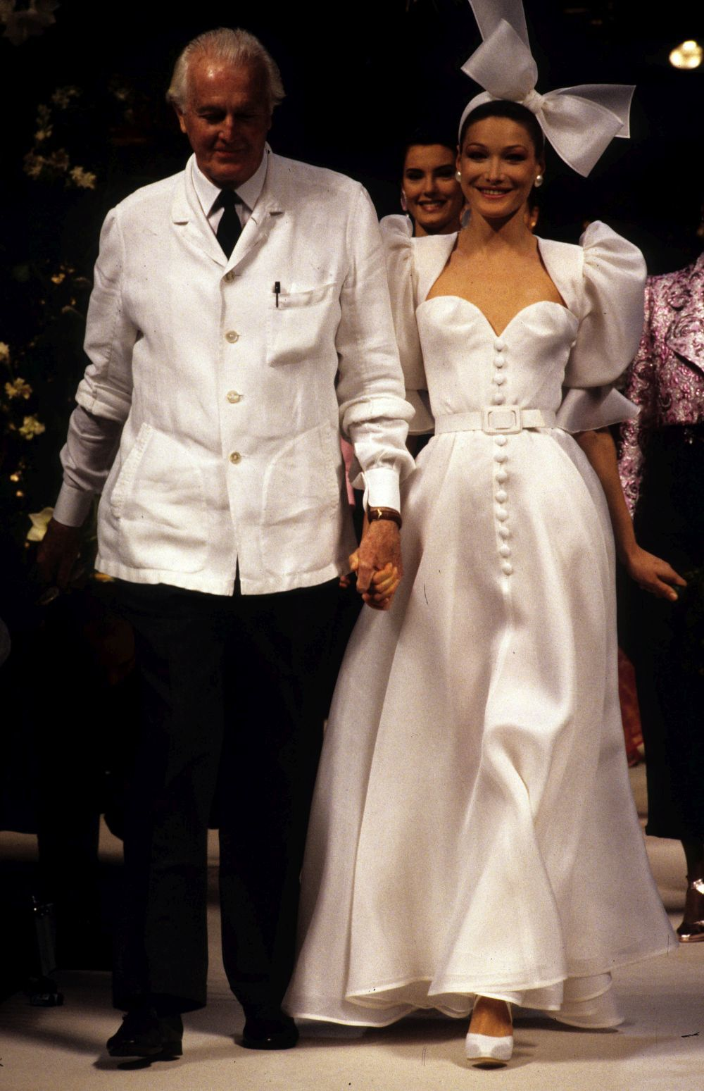 PARIS - (FILE) Model Carla Bruni walks the catwalk during Givenchy show High Fashion (circa 1993) in Paris, France. According to reports, December 18, 2007 French President Nicolas Sarkozy has asked the Italian model turned pop singer to marry him. (Photo by Michel Dufour/WireImage)