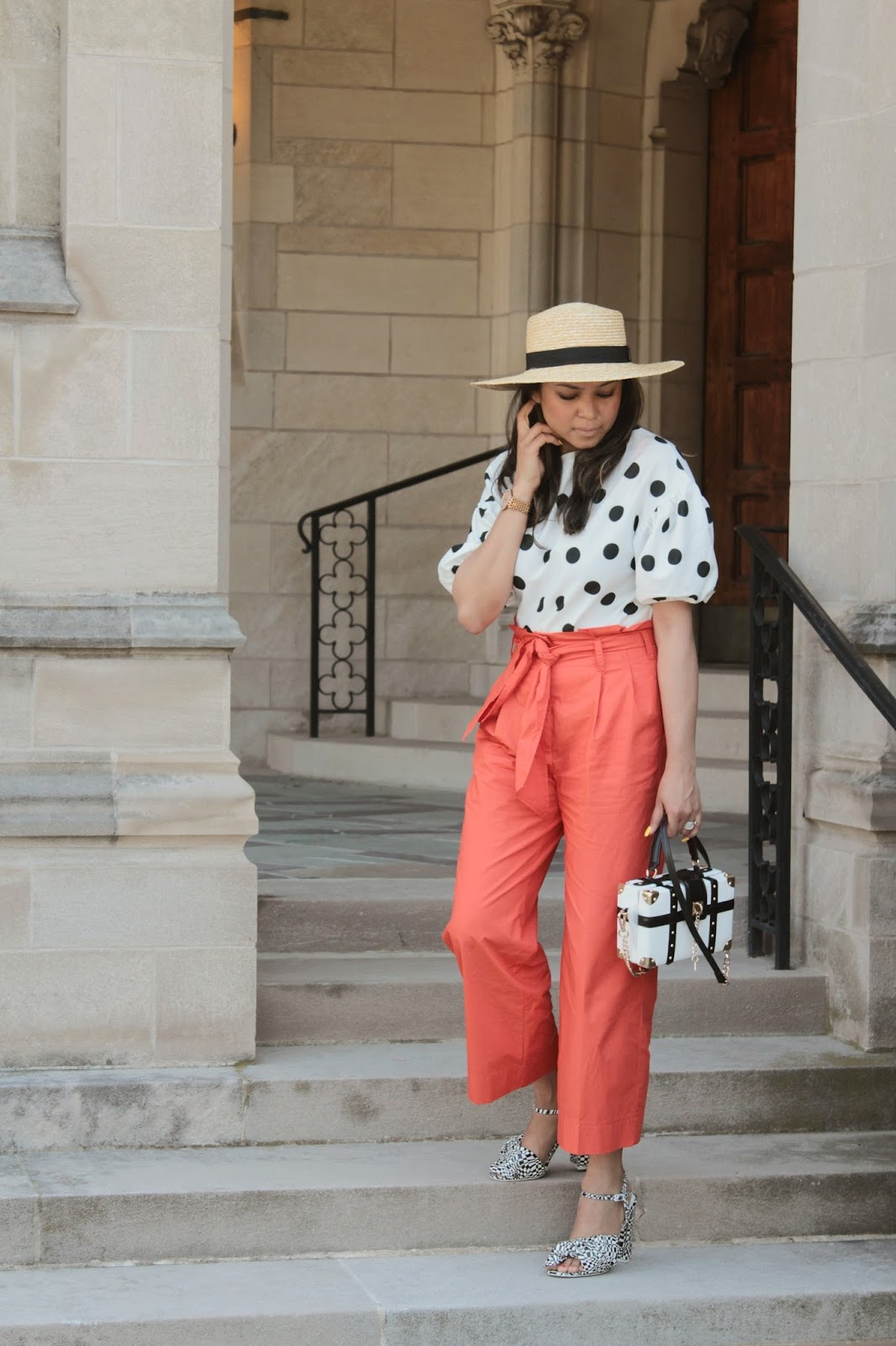 how to wear polka dots, zara puff sleeve blouse, orange paper bag waist pants outfit, printed sandals, white and black, orange trousers, high waisted, boxed bag, myriad musings 2
