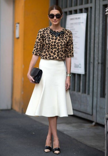 White-midi-skirt-streetstyle-Pair-your-new-midi-skirt-with-a-bold-print-and-pumps-for-a-fun-updated-look.-Concrete-Runway-381x550